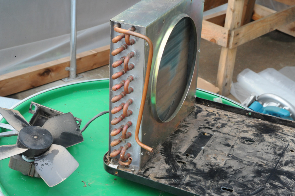 this repurposed heat exchanger can scrub away the heat captured and be distributed with fans for aerial heating